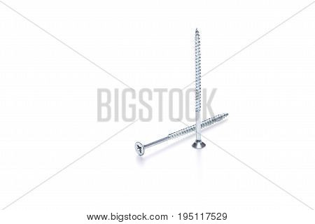 Photo of long two screws on empty white background