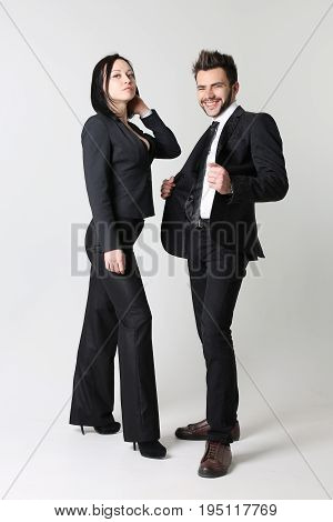 Fashion man and woman gray backgroung two