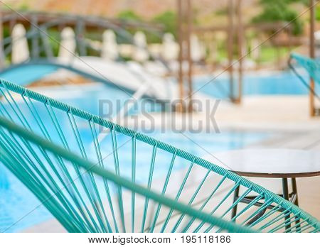 Blue chaise longue close up on a blurred pool background Greece