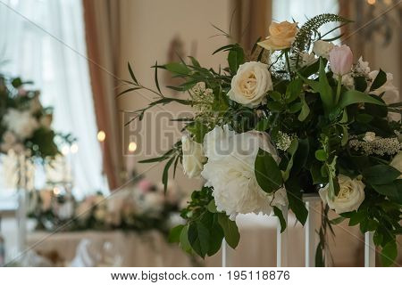 Decorated wedding table with flowers, candles and the candlesticks