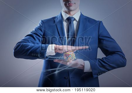 Intention concept. Young noble businessman is expressing confidence while holding little colorful ball in his hands