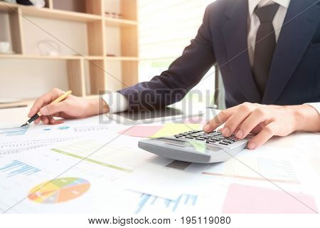 BusinessMan working with calculator business document and laptop computer notebook vintage ton