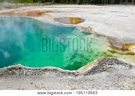 Black Pool Hot Spring in the West Thumb Geyser Basin in Yellowstone National Park.