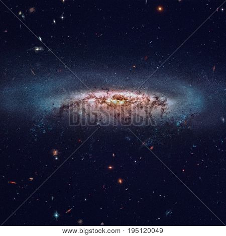 NGC 4522 is a barred spiral galaxy in the constellation Virgo. Retouched image. Elements of this image furnished by NASA.