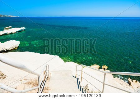 Beautiful Beach With White Cliff And Blue Sea