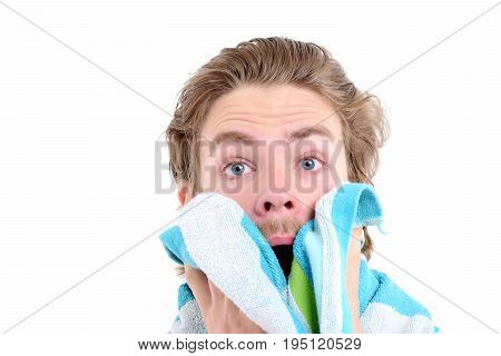 Man With Surprised Face, Beard And Brushed Hair Wipes Face