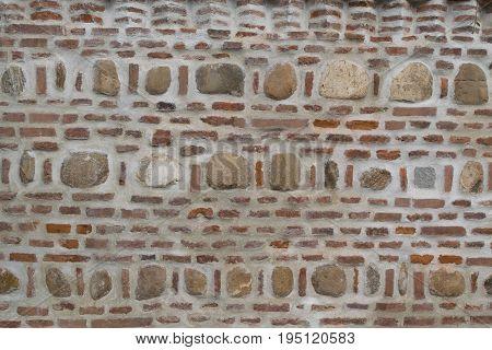 brick and natural stone masonry wall background