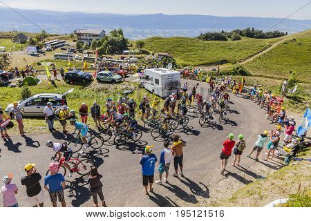 Col du Grand ColombierFrance - July 17 2016: The peloton riding in a hairpin curve at Col du Grand Colombier in Jura Mountains during the stage 15 of Tour de France 2016.