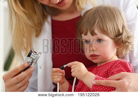 Little child with stethoscope at doctor reception. Physical exam cute infant portrait baby aid healthy lifestyle ward round child sickness specialist clinic test pulse concept