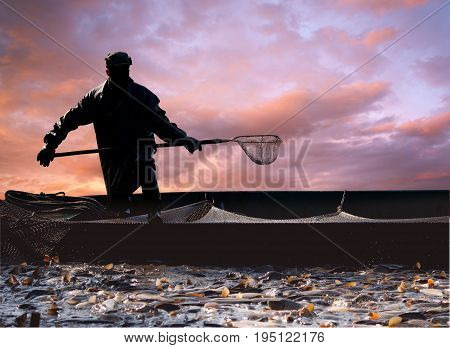 Picture of fishermen catching fish in sunset