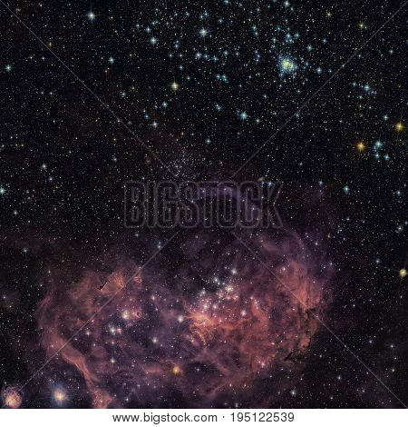 The broad vista of young stars and gas clouds in our neighbouring galaxy, the Large Magellanic Cloud. Retouched colored image. Elements of this image furnished by NASA.
