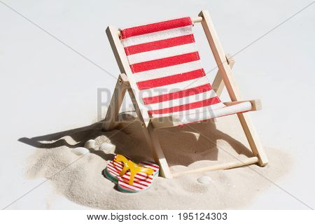 Empty sunbed on the beach on sand abstract