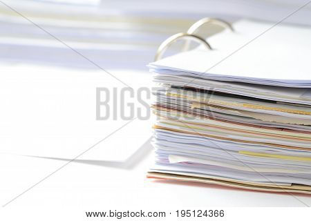 Business documents in document file at workplace with copy space for text,office supplies,high key tone.