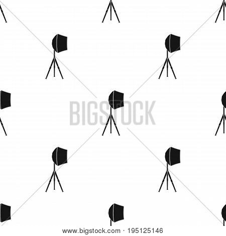 Lighting device on a tripod.Making movie single icon in black style vector symbol stock illustration .