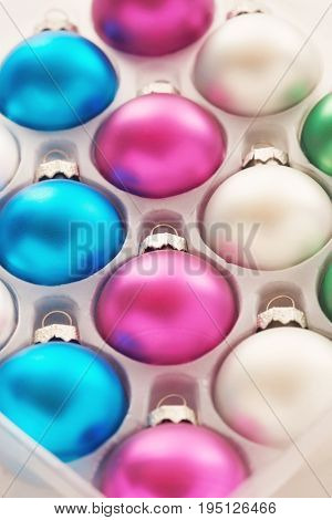 Christmas baubles in tray close-up