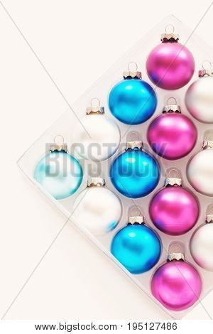 Christmas baubles in tray on white background