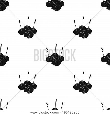 Olive with a pit on a stick.Olives single icon in black style vector symbol stock illustration .