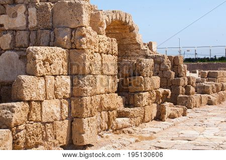Roman falled stone wall with door in caesarea Archaeological site close to Herod the Great hippodrome