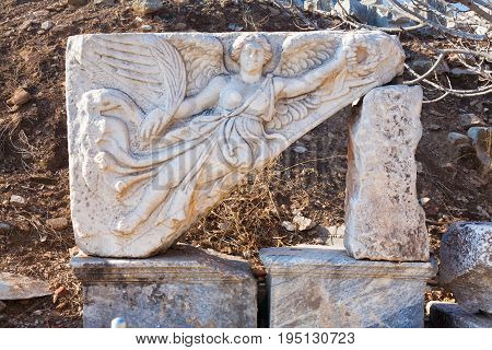 Classic White Roman angel bas-reflief wall decoration in Temple Door with stone statue in ephesus Archaeological site in turkey
