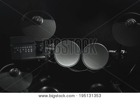 Old electronic Drum Kit on black background close-up photo.