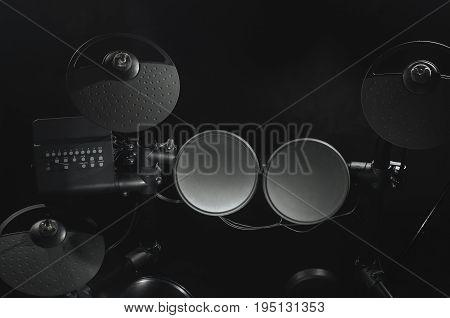 Old electronic Drum Kit on black background close-up photo.