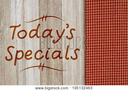 Today's Specials hand lettering text on a weathered wood with retro napkin
