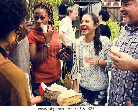 Group of Diverse People Testing Cheese at Food Stall