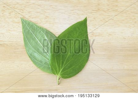 Betel leaves (pan patta) on a wooden background