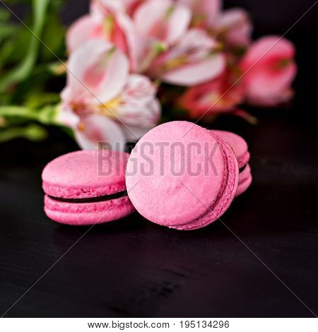Classic French Macaroons On A Black Background