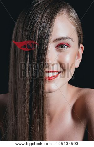 Obscured View Of Smiling Woman With Red Lips Posing For Fashion Shoot Isolated On Black