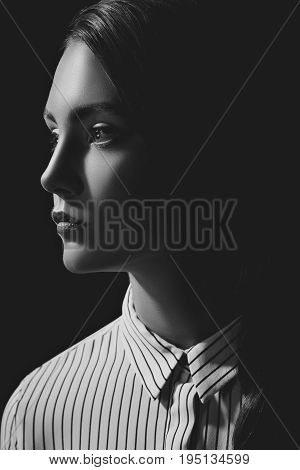 Black And White Portrait Of Pensive Woman In Shirt Looking Away