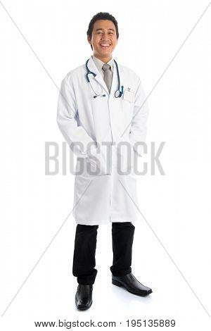 Full length front view attractive young male Southeast Asian medical doctor standing isolated on white background.