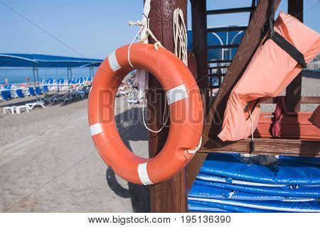 orange lifebuoy on the sea coast at summer
