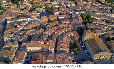 Aerial top view of Bram medieval village architecture and roofs from above, Southern France
