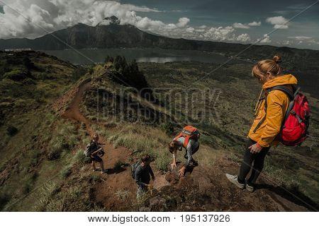Team of hikers walking in the valley