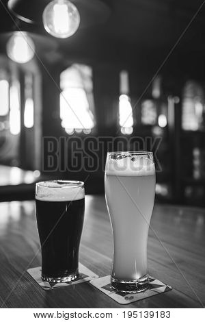 Light and dark beer in a glass black and white frame