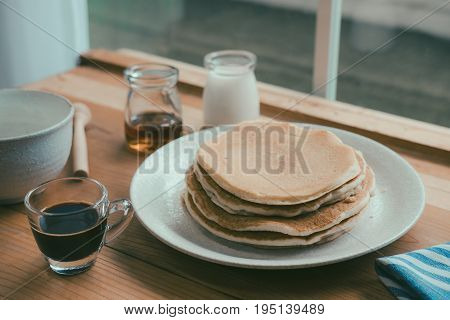 Pancakes for Breakfast Delicious Breakfast pancakes and coffee Coffee with milk vintage tone