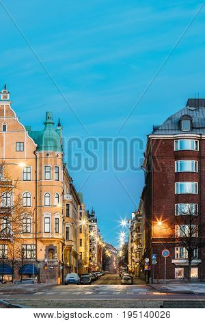Helsinki, Finland. Residential House Building At Intersection Of Merikatu, Neitsytpolku And Puistokatu Streets In Winter Morning Evening. Ullanlinna Neighbourhood, District