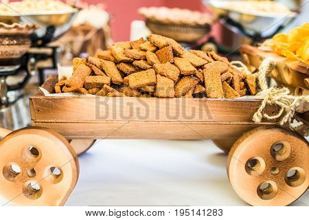 Crackers in a small decorative wooden cart