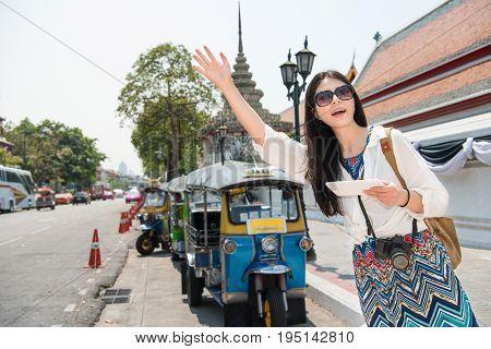 Hailing A Tuk Tuk Taxi Car On The Street