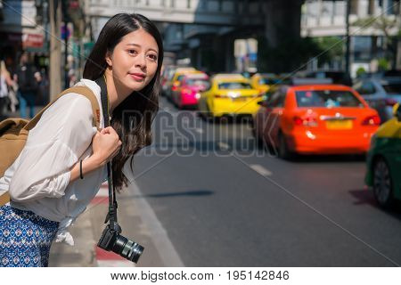 Woman Waiting Taxi On The Road. Asian Woman