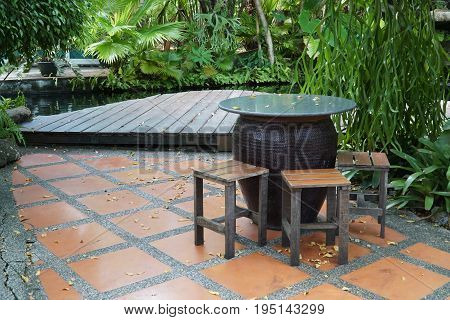 table and chairs on the terrace in the garden