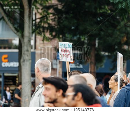 STRASBOURG FRANCE - JUL 12 2017: Young and senior people with placards at protest against Macron government spending cuts and pro-business tax and labor reforms