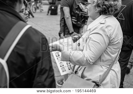 STRASBOURG FRANCE - JUL 12 2017: Senior women debating at protest against Macron government spending cuts and pro-business tax and labor reforms