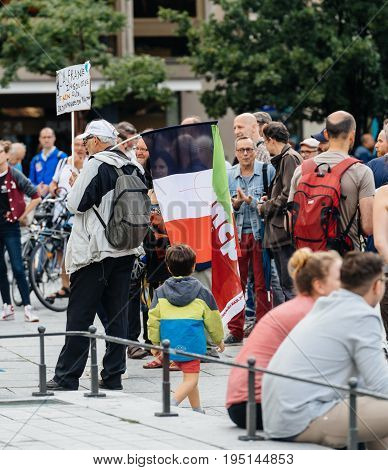 STRASBOURG FRANCE - JUL 12 2017: Protesters in city as Melenchon called for day of protest against Macron government spending cuts and pro-business tax and labor reforms