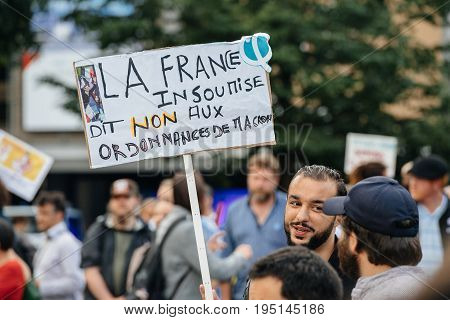 STRASBOURG FRANCE - JUL 12 2017: Placards at protesters in city as Melenchon called for day of protest against Macron government spending cuts and pro-business tax and labor reforms