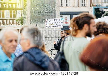 STRASBOURG FRANCE - JUL 12 2017: No to Macron laws - Protesters in city as Melenchon called for day of protest against Macron government spending cuts and pro-business tax and labor reforms