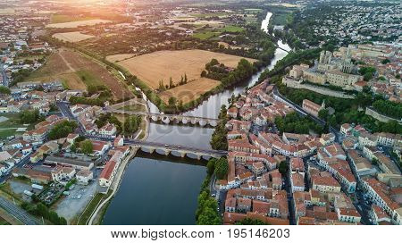 Aerial top view of Beziers town, river and bridges from above, South France