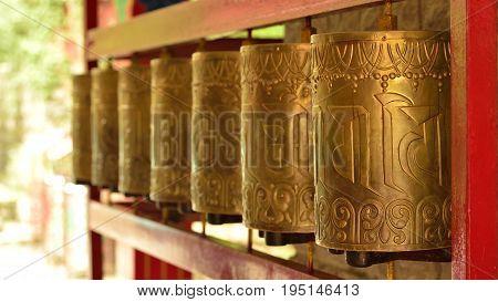 Tibetan praying wheels at Norbulingka Institute Dharamshala India