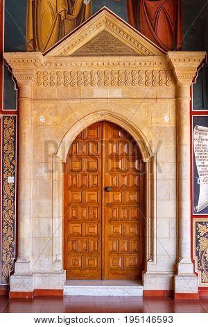 CYPRUS PAPHOS- SEPTEMBER 21 2016: Big wooden door in the famous Kykkos monastery.